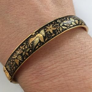 Gold plated bird hinged bangle